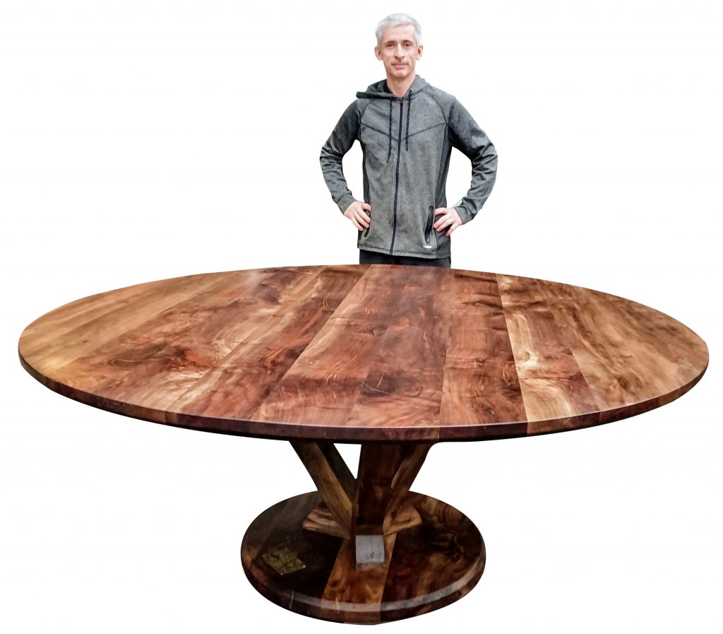 Large round walnut table made from clients slabs of walnut