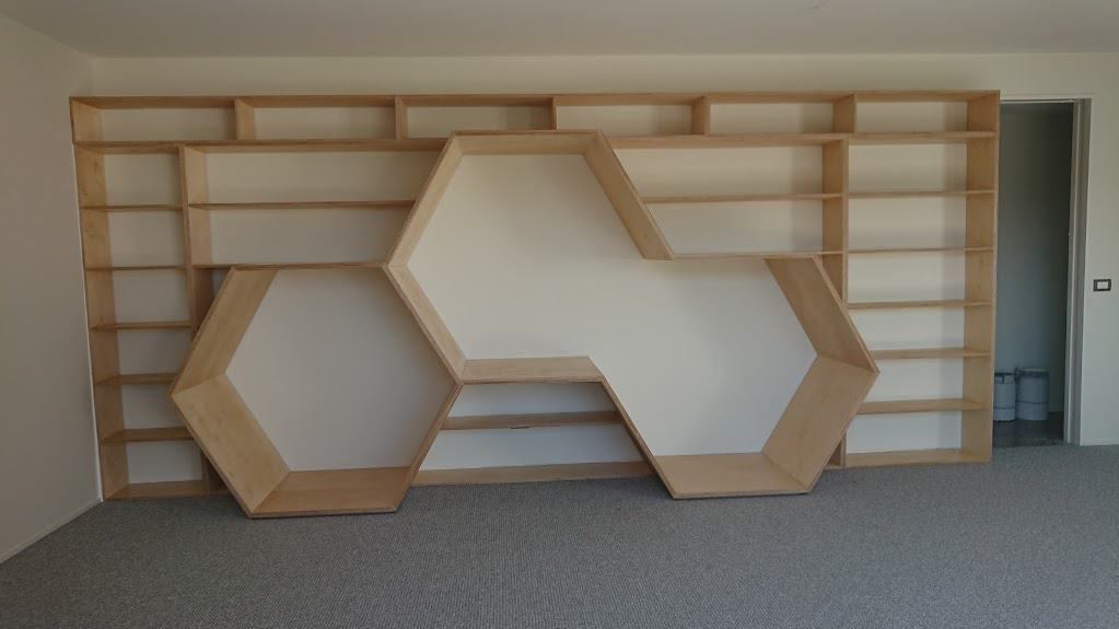 The Honeycomb Bookcase - playroom bookcase with reading nooks (upholstered cushions to be added).